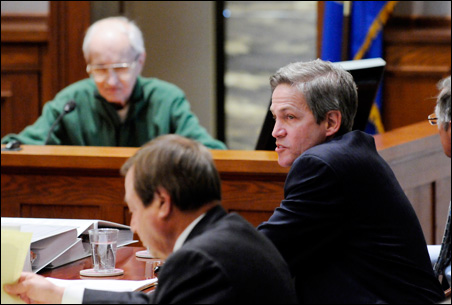 Norm Coleman listens as Gerald Anderson, a St. Paul resident who is blind, testifies about his rejected absentee ballot.