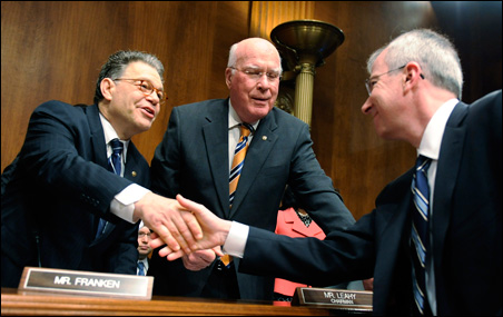 """Subcommittee Chairman Al Franken and Committee Chairman Patrick Leahy greet Apple Vice President of Software Technology Guy """"Bud"""" Tribble before Tuesday's hearing."""