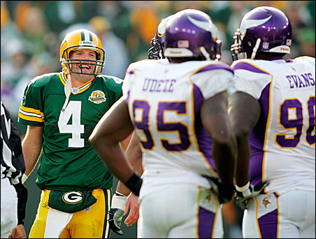 In a November game that proved to be their final gridiron meeting, Packers quarterback Brett Favre and Vikings defensive players exchange banter during the fourth quarter of Green Bay's 34-0 home-field drubbing of Minnesota.