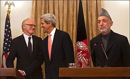 U.S. Senator John Kerry (C) shakes hands with the United Nations Special Envoy to Afghanistan Kai Eide after his speech during a news conference with Afghan President Hamid Karzai