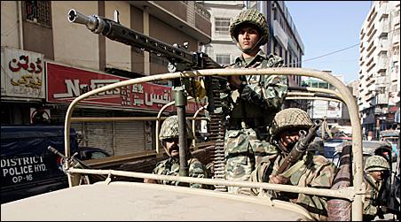Pakistani soldiers patrol a street in Hyderabad