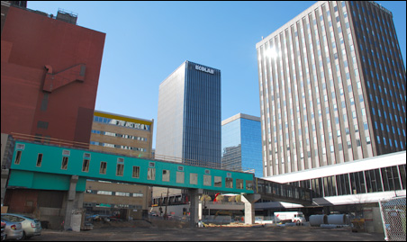 The skyway link was temporarily severed last spring to permit the demolition of the vacant Bremer Bank.