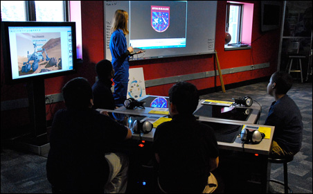 Students use computers to design rockets for their mission to Mars.