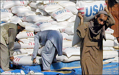 Workers load bags of food aid from the U.S. during food loading operations in Quetta back in 2001. USAID has recently initiated a probe into accusations that the Taliban takes its money meant for large development projects, like roads and bridges.