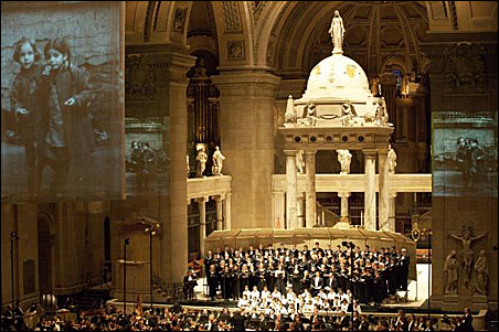 """Photos of Eastern European children who died in the Holocaust were projected on screens during the 2005 premiere of """"To Be Certain of the Dawn"""" at the Basilica of St. Mary in Minneapolis, which commissioned the oratorio."""