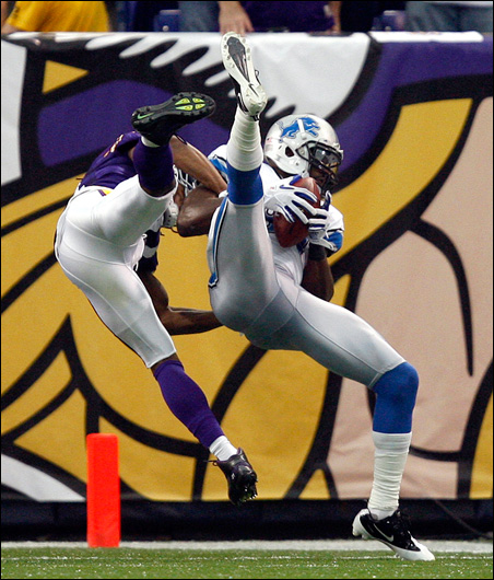 Lions wide receiver Calvin Johnson catches a 32-yard touchdown pass over Vikings safety Jamarca Sanford during the third quarter.