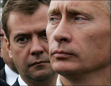Russian President Vladimir Putin (R) and First Deputy Prime Minister Dmitry Medvedev