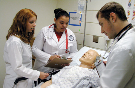 Lake Superior College uses simulation to teach medical terms in Spanish. Left to right are students Jessica Beckman, Eva Nordling and Paul Williams.