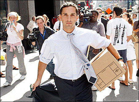 Lehman Brothers' bankruptcy means layoffs on Wall Street: A man walks out of the Lehman Brothers building in New York on Monday carrying a box of his belongings.