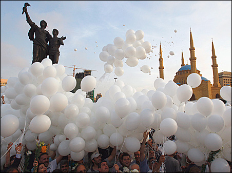 Lebanese people release white balloons in Martyr's Square in Central Beirut to celebrate an 11th-hour agreement ending the worst conflict since the civil war.