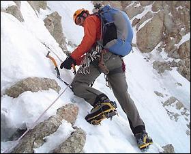 Dean Einerson climbs the steep rock of Cassin Ridge on Mount McKinley.