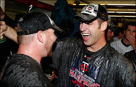 Jason Kubel and Joe Mauer celebrate after the Twins's victory over the Detroit Tigers in their MLB American League Central Division play-in game in October.