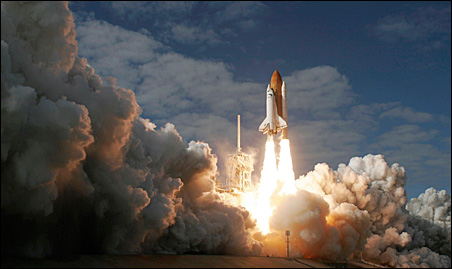 Space shuttle Atlantis lifts off from launch pad 39A at the Kennedy Space Center on Monday.