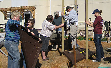 Volunteers work on the grounds of Creekside Commons.