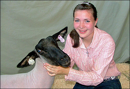 Jaclyn Dingels posing with her sheep.