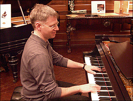 Jeremy Walker tries out a piano during a recent trip to New York City.