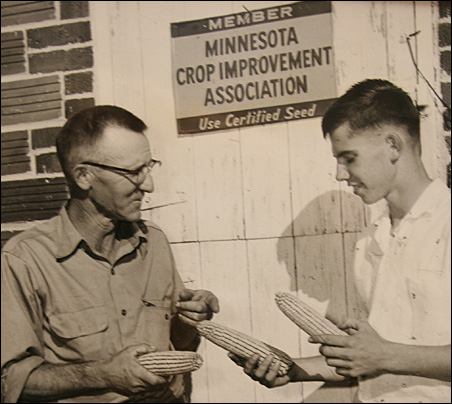 Ron Kelsey, right, and his father, Dale, discuss the finer points of prize-winning corn in the 1950s.