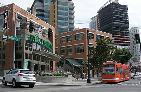 A streetcar stops for grocers at a supermarket in Seattle's booming South Lake Union District.