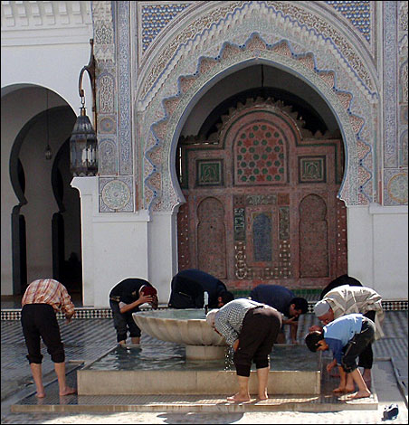 Men prepared for prayer at a mosque in Fez.