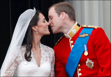 Prince William and his wife Catherine, Duchess of Cambridge, share a kiss on the balcony at Buckingham Palace after their wedding on Friday.