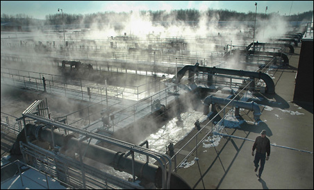 Steam rises from the final settling tanks at the Metro Plant in St. Paul.