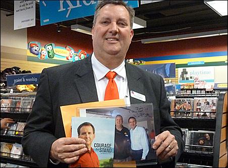Jim Kirkpatrick, head of Iowans for Pawlenty, displays his autographed mementos.