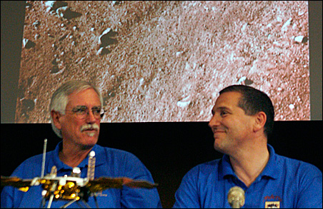Mission leaders Peter Smith, left, and Barry Goldstein show the first color image from the Phoenix Mars Lander.