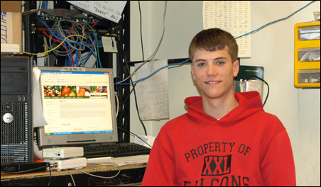 Jordan Wolf uses computers to plot field plans and analyze yields on his family's farm.