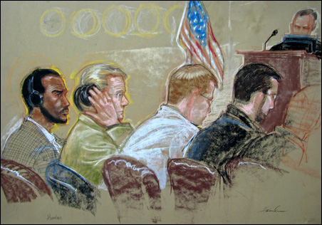 A courtroom sketch shows Salim Ahmed Hamdan and his legal team during an arraignment at Guantanamo in 2007.