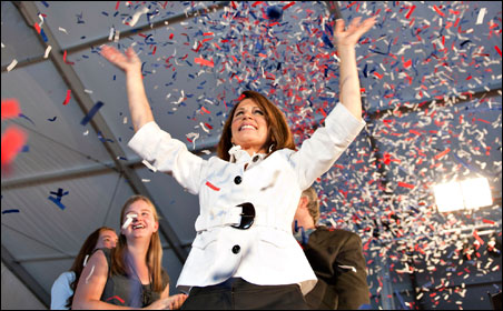 Presidential candidate Michele Bachmann, winner of today's Iowa straw poll, waves to supporters after her speech.