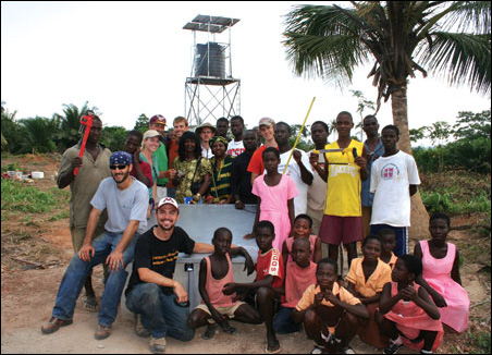 The Engineers Without Borders team is all smiles after finishing the water tower for villagers and students.
