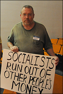 Douglas Bass brought a sign featuring a Margaret Thatcher quotation.