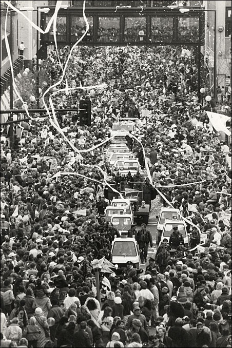 The parade through Minneapolis and St. Paul sometimes came to a complete stop, as it did here on Wabasha Street, as fans mobbed their team.