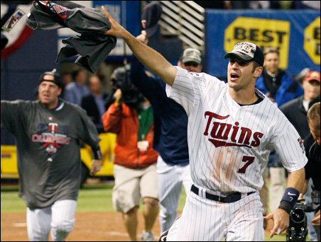Joe Mauer led teammates on the field after the Twins defeated the Detroit Tigers in their MLB American League Central Division play-in game in October.