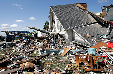 A work crew removes debris from a farmhouse that was destroyed by a tornado in Lake Township, Ohio, on June 6.