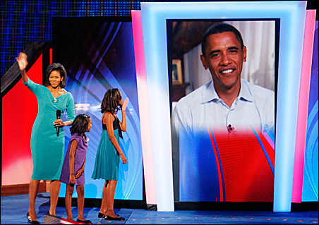Hi, Dad: Sasha and Malia Obama greet the candidate via live video feed after mom's speech (Michelle Obama at left) Monday night.