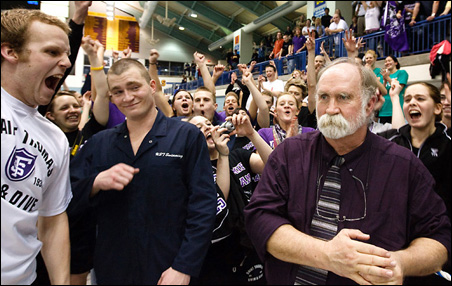 St. Thomas swimmers and divers cheer for coach Tom Hodgson, right, as he is announced as the MIAC men's swimming coach of the year.