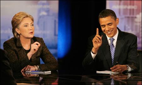 Barack Obama readies a response to Hillary Clinton during their Ohio debate.