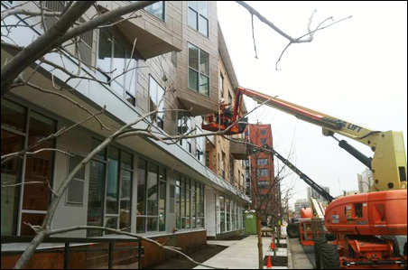Workers put finishing touches on Mill District City Apartments last week.