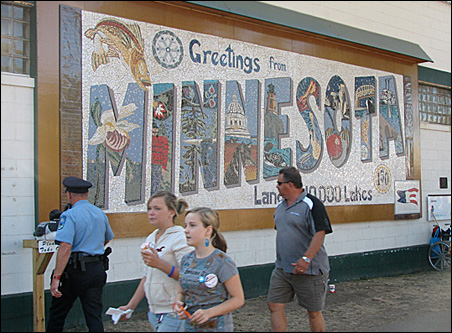 Susan Warner designed the gigantic mosaic postcard, and created it with help from children and others throughout the state.