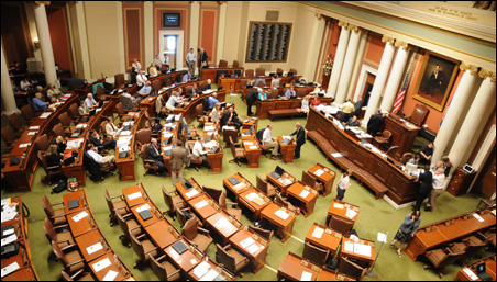 The 12 hour-plus session, which wrapped up after 3 a.m., rushed through each budget bill on largely party-line votes.