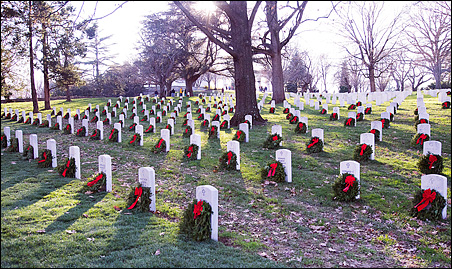 About 15,000 volunteers helped lay the wreaths at Arlington National Cemetery.