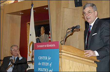 Former Vice President Walter Mondale looks on as Alberto Mora delivers his lecture on Tuesday.
