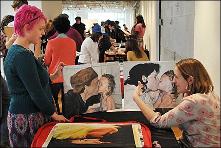 Elyan Paz, right, reviews the portfolio of Nikki Ivanovsky-Schow, 17, an Arts High senior from Woodbury.