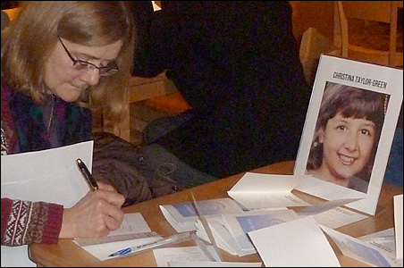 People signed condolence cards for the family of Christina Taylor Green.