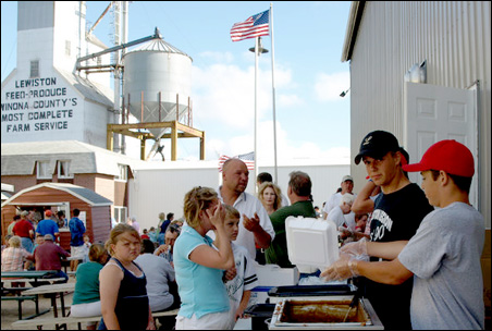 Lewiston celebrated Heartland Days with a chicken barbeque and other festivities even though the town has lost some 200 jobs and its only grocery store this year.