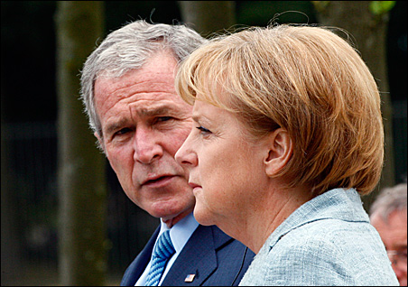 President Bush and German Chancellor Angela Merkel talk during a news conference outside Berlin on Wednesday.