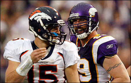 Jared Allen looking at Denver Broncos quarterback Tim Tebow after Allen sacked Tebow and recovered the ensuing fumble during Sunday's game.