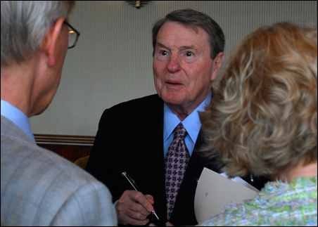 Jim Lehrer shown autographing a book during a University of Minnesota Friends of the Libraries event on Friday.