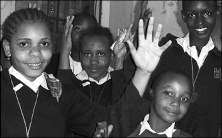 Hearing-impaired students at Ilburo Primary school sign a song.
